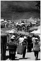 Periphery of  Monday market frequented by hill tribespeople. Shaping, Yunnan, China (black and white)