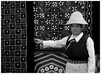 Woman in Bai dress showing drapes of traditional design. Dali, Yunnan, China (black and white)