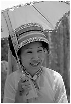 Woman from the Sani branch of the Yi tribespeople with a sun unbrella. Shilin, Yunnan, China (black and white)