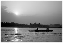 Fishermen at the confluence of the Dadu He and Min He rivers at sunset. Leshan, Sichuan, China (black and white)