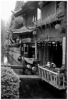 Restaurant across the canal. Lijiang, Yunnan, China (black and white)