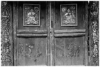 Decorated doors of a temple. Lijiang, Yunnan, China ( black and white)