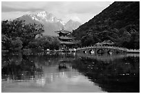Pavillon and Jade Dragon Snow Mountains reflected in the Black Dragon Pool. Lijiang, Yunnan, China (black and white)