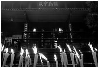 Candles burning in front of Wannian Si temple. Emei Shan, Sichuan, China ( black and white)