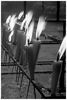 Candles burning. Emei Shan, Sichuan, China ( black and white)