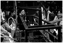 Pilgrims burning big incense batons. Emei Shan, Sichuan, China ( black and white)