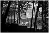 Bailongdong temple seen through trees. Emei Shan, Sichuan, China ( black and white)