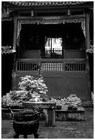 Buddha image seen from rainy courtyard of Hongchunping temple. Emei Shan, Sichuan, China ( black and white)