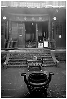 Urn in courtyard inside Xixiangchi temple. Emei Shan, Sichuan, China ( black and white)