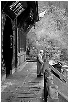 Monk in front of Jieyin Palace. Emei Shan, Sichuan, China ( black and white)