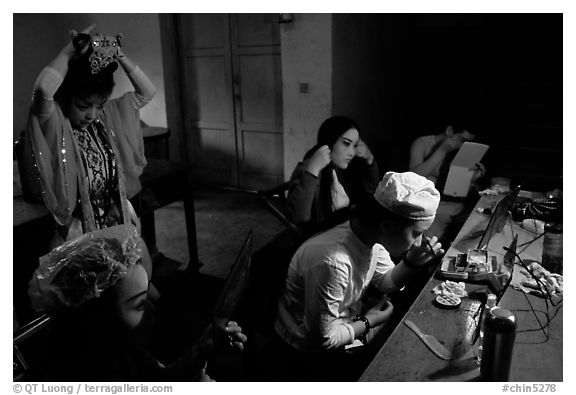 Sichuan opera actors getting ready in the backstage before the performance. Chengdu, Sichuan, China (black and white)