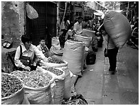 Large bags of dried food items. Guangzhou, Guangdong, China ( black and white)