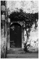 Wooden door with lanterns and flowers. Hongcun Village, Anhui, China ( black and white)