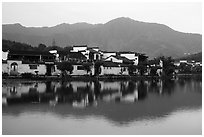 Hongcun village and mountains reflected in South Lake. Hongcun Village, Anhui, China ( black and white)