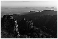 Stone Monkey Watching the Sea view at sunrise. Huangshan Mountain, China ( black and white)