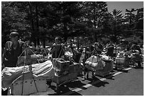 Porters resting heavy loads on pole. Huangshan Mountain, China ( black and white)