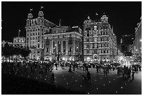 Colonial-area buildings illuminated at night, the Bund. Shanghai, China ( black and white)