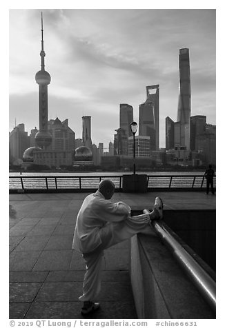 Man stretching and Oriental Pearl Tower, the Bund. Shanghai, China (black and white)