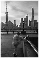 Man stretching and Oriental Pearl Tower, the Bund. Shanghai, China ( black and white)
