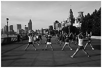 Morning group exercise on the Bund. Shanghai, China ( black and white)