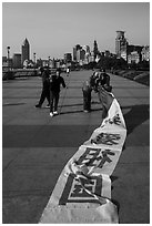 Men folding kite, the Bund. Shanghai, China ( black and white)