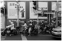 Motercycle riders waiting at trafic light. Shanghai, China ( black and white)