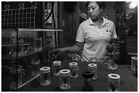Woman selling insects. Shanghai, China ( black and white)