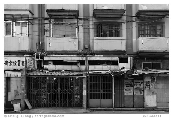 Dilapidated buildings slated for demolition. Shanghai, China (black and white)