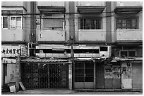 Dilapidated buildings slated for demolition. Shanghai, China ( black and white)