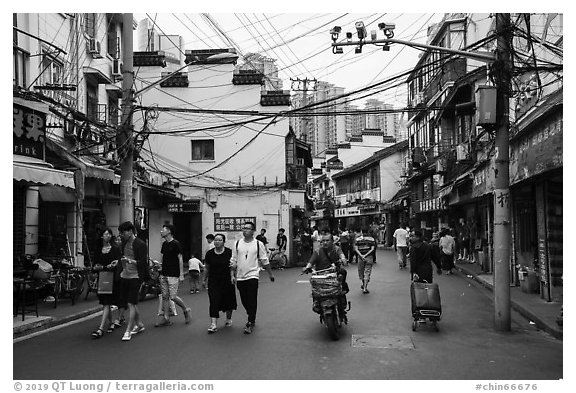 Old street with surveillance cameras. Shanghai, China (black and white)