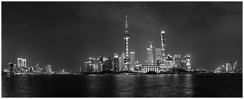 Shanghai city skyline from the Bund at night. Shanghai, China (Panoramic black and white)