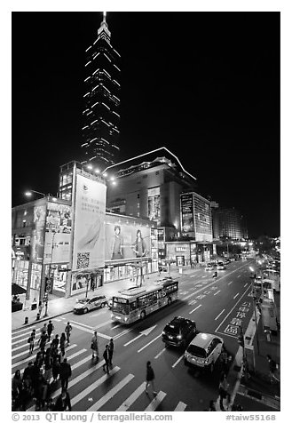 Shopping district street at night and Taipei 101. Taipei, Taiwan