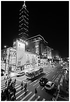 Shopping district street at night and Taipei 101. Taipei, Taiwan (black and white)