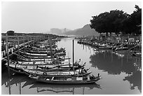Small boat harbor along Damshui River. Taipei, Taiwan ( black and white)