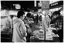 Customer buying foods at Shilin Night Market. Taipei, Taiwan ( black and white)