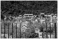 Prayer flags and graves on hillside, Chongde. Taiwan (black and white)