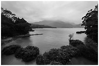 Cove with floating rafts on which plants are being grown. Sun Moon Lake, Taiwan (black and white)
