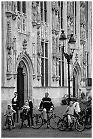 People standing on the Burg, in front of the Stadhuis. Bruges, Belgium (black and white)
