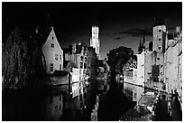 Old houses and beffroi Quai des Rosaires, night. Bruges, Belgium (black and white)