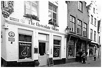 Street with chocolate shop. Bruges, Belgium (black and white)