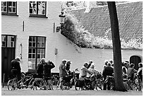 Bicylists in Courtyard of the Begijnhof. Bruges, Belgium (black and white)