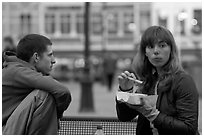 Young woman eating fries, Markt. Bruges, Belgium ( black and white)