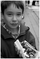 Boy eating a Belgian waffle. Brussels, Belgium (black and white)