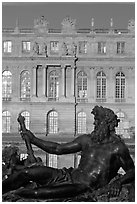 Statue, basin, and Versailles palace facade, late afternoon. France ( black and white)