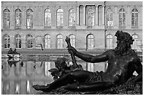 Statue, basin, and facade, late afternoon, Versailles Palace. France ( black and white)