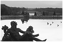 Sculptures, basin, and gardens at dusk, Palais de Versailles. France ( black and white)