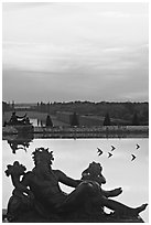 Sculptures, basin, and gardens at dusk, Versailles Palace. France ( black and white)
