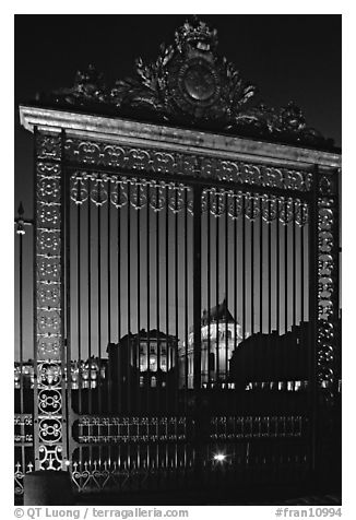 Versailles Palace gates at night. France (black and white)