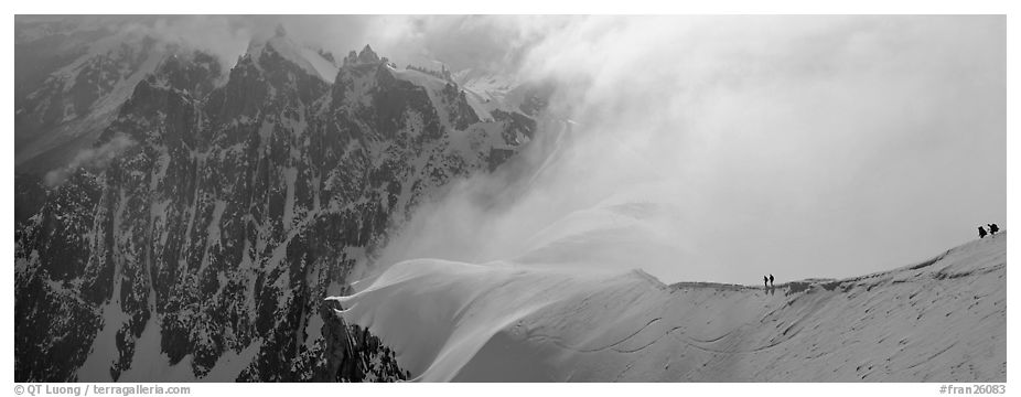 Ridge with alpinists and high peaks. France (black and white)