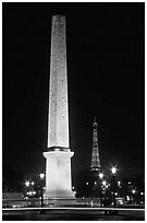 Luxor obelisk of the Concorde plaza and Eiffel Tower at night. Paris, France ( black and white)